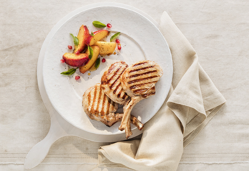 BBQ pork cutlets with grilled peaches