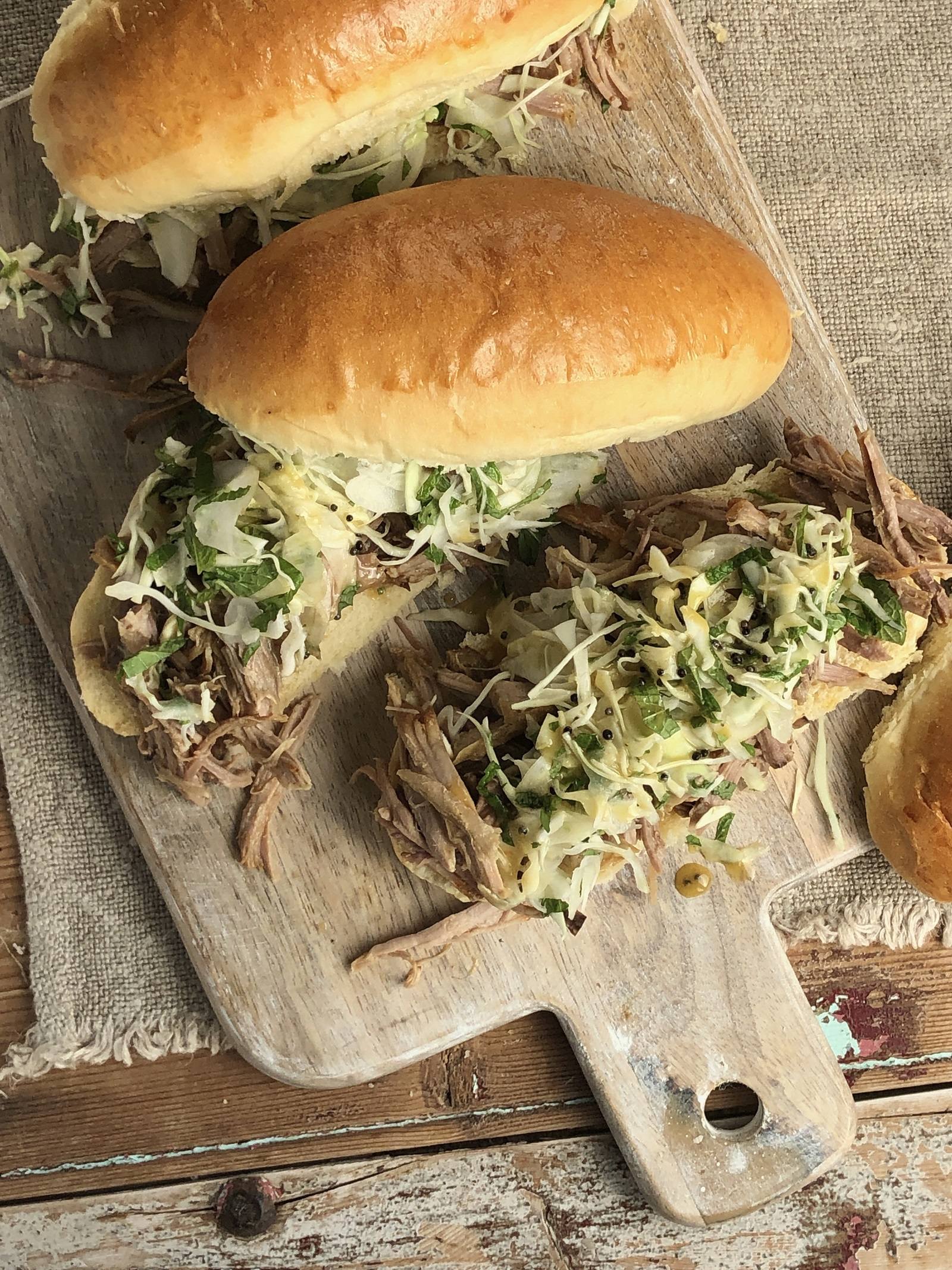 Brined and spiced roast pork shoulder cooked in cider with fennel and cabbage slaw
